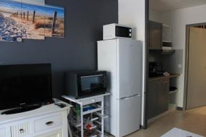 A television and/or entertainment center at Les Residences Pinea