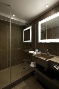 A bathroom at Novotel Leuven Centrum