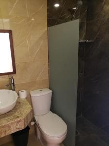 Vonios kambarys apgyvendinimo įstaigoje Cordoba Suites