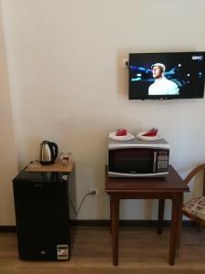 Televizorius ir (arba) pramogų centras apgyvendinimo įstaigoje Cordoba Suites