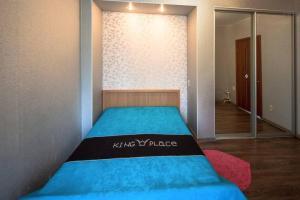 Кровать или кровати в номере Apart-Comfort Volkova 6