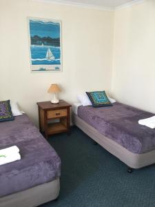 A bed or beds in a room at Beach Breakers Resort
