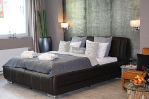 A bed or beds in a room at VitaLounge Sports & Spa Hotel