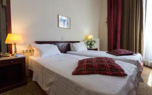 A bed or beds in a room at Hotel Venezia by Zeus International