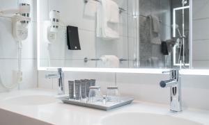 Łazienka w obiekcie Thon Hotel Storo