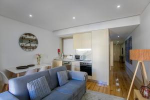 A kitchen or kitchenette at Cedofeita Bohemian Lifestyle Apartment