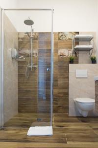 A bathroom at Living Apartments Poznań
