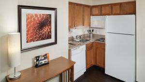A kitchen or kitchenette at Staybridge Suites Jackson, an IHG Hotel