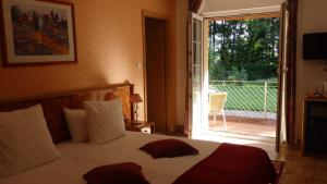 A bed or beds in a room at Hotel Sud Alsace