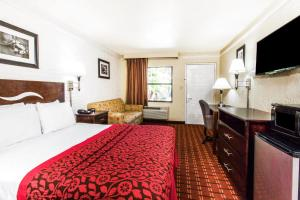 A television and/or entertainment center at Days Inn & Suites by Wyndham Altamonte Springs