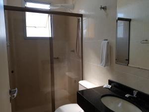 Um banheiro em Astro Hotel