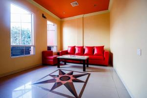 A seating area at RedDoorz Plus near DC Mall Batam