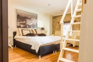 Cama o camas de una habitación en Hotel Berneau