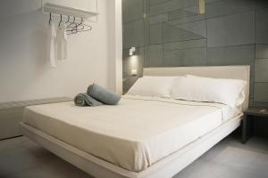 A bed or beds in a room at MADA Charm Apartments Terrace&Carugio