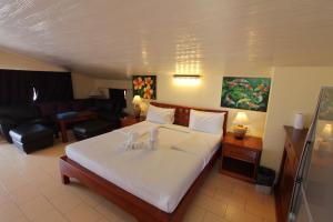 Ein Bett oder Betten in einem Zimmer der Unterkunft Top Resort