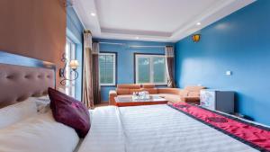 Кровать или кровати в номере Sapa Eden Hotel