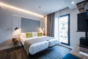Cama o camas de una habitación en Hotel Villa Victoria By Intur