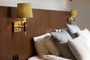 Säng eller sängar i ett rum på Calmar Stadshotell