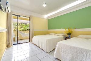 Cama ou camas em um quarto em Floral Inn Family