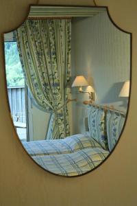 Un ou plusieurs lits dans un hébergement de l'établissement Hôtel Restaurant Taillard