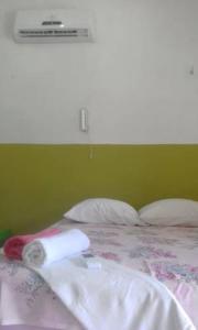 A bed or beds in a room at Pousada Recanto Atalaia