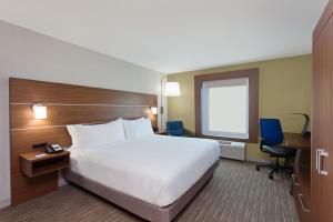 A bed or beds in a room at Holiday Inn Express West Los Angeles, an IHG Hotel