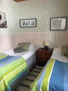 A bed or beds in a room at E-City B&B