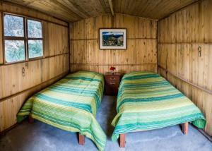 Un ou plusieurs lits dans un hébergement de l'établissement Llahuar Lodge