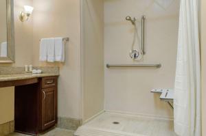 A bathroom at Homewood Suites by Hilton Covington