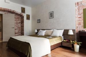 Кровать или кровати в номере For4 byApartica