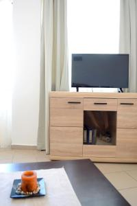 A television and/or entertainment centre at GreeceRent - LADADIKA