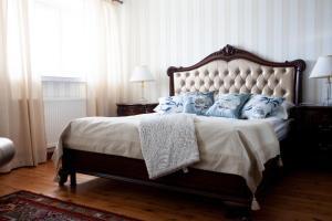 Ein Bett oder Betten in einem Zimmer der Unterkunft Hotel Hospitz