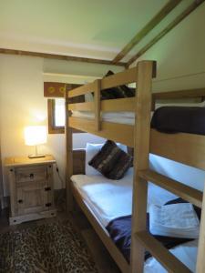 A bunk bed or bunk beds in a room at Adventurer's Village Milton Keynes