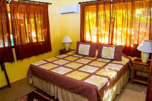 Cama ou camas em um quarto em BORA - Fare Matira