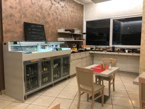 Cucina o angolo cottura di Hotel Nuova Orchidea