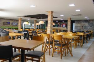 A restaurant or other place to eat at Roma Hotel