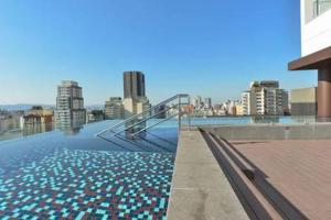 The swimming pool at or close to Your Studio at London SP Residences