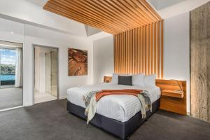 A bed or beds in a room at Peppers Silo