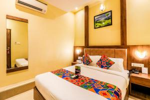 A bed or beds in a room at Hygenic Hotel Lotus Grand Andheri
