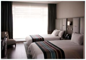 A bed or beds in a room at Casa Grande Hotel