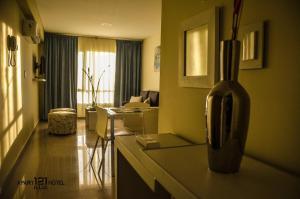 Un lugar para sentarse en ILLIA 121 APART HOTEL