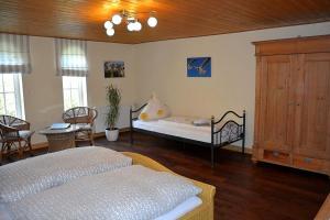 Ein Bett oder Betten in einem Zimmer der Unterkunft Gutshaus Zietlitz