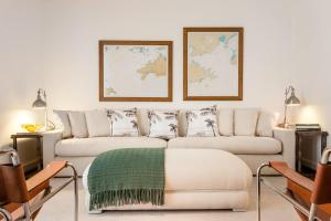 Postel nebo postele na pokoji v ubytování Vila Santa Teresa