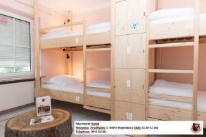 A bunk bed or bunk beds in a room at Microverse Hostel