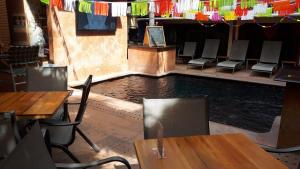 A restaurant or other place to eat at Hotel Mercurio - Gay Friendly
