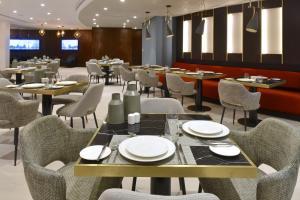 مطعم أو مكان آخر لتناول الطعام في Swiss-Belresidences Juffair