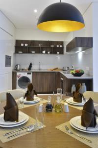 مطبخ أو مطبخ صغير في Swiss-Belresidences Juffair
