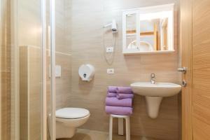 Ein Badezimmer in der Unterkunft Camping Castelpietra