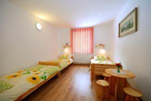 Posteľ alebo postele v izbe v ubytovaní Privat Monika
