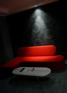 Ein Sitzbereich in der Unterkunft Met Boutique Hotel